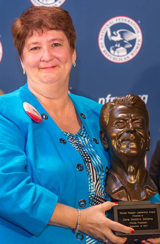 Dena DeCamp, president of the Florida Federation of Republican Women, receives the seventh biennial Ronald Reagan Leadership Award in September 2017.