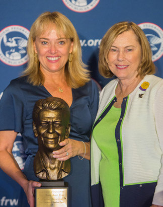Karen Newton, president of the Texas Federation of Republican Women, receives the eighth biennial Ronald Reagan Leadership Award in September 2019.